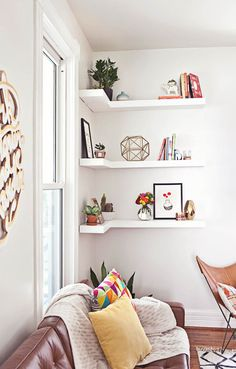 ABM living room makeover - Like this corner shelf idea.