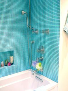Blue tiled shower with wall nitch perfect for kids bathrooms. Available at Just Floors Westfield, IN