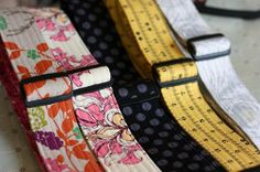 """Add some unique flair to your guitar with a custom guitar strap... makes a great gift for musicians. Guitar Strap Tutorial; posted by Amber Carrillo of """"One Shabby Chick"""" (via FaveCrafts)."""