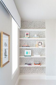 Adding wallpaper or colour pops behind shelves is a great way to use bright colours or bold patterns into a small space without overwhelming it.