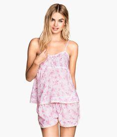 Light pink floral pajama tank top & short set with lace trim. Decorative buttons, adjustable shoulder straps, and elasticized drawstring waistband. | H&M Pastels