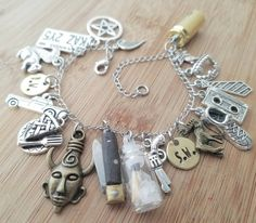 Supernatural charm bracelet featuring a functional pocket knife! Designed and Sold exclusively by Wanderlust Hearts© This supernatural charm bracelet is loaded with the coolest charm assortment out th