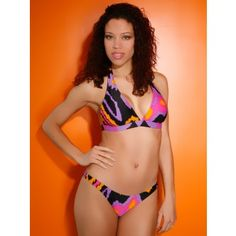 Zephyr Halter Bikini by Tibi Swimwear a at Pesca Boutique. Tibi Zephyr Halter two piece is very retro and has a very vintage style to it. The Support on the top is great and the top also has removable pads. The pink, purple, orange, and black blend very well together on this Tibi bikini. This Bikini has UV Protection. The bottom is a Brazilian cut which is very sexy. - Special Price: $98.00