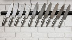 Kitchen knives set on white wall Stock Photos , White Brick Background, Kitchen Photos, Magnetic Knife Strip, Knife Sets, Wood Species, Knife Block, Kitchen Knives, White Walls, Kitchen White