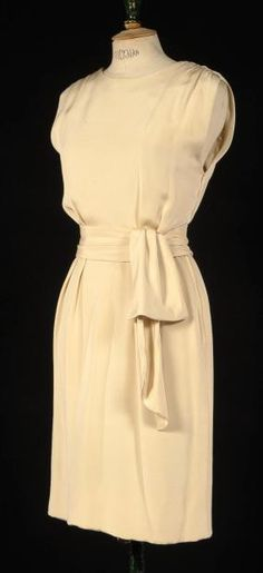 GIVENCHY  Haute couture, No. 82511, circa 1990 cocktail dress ivory silk halter round neckline on two straps draped straight skirt, highlighted by a draped rosette belt