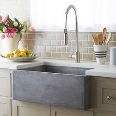 Cooking implements, appliances and storage are also important facets of farmhouse kitchen design. Sinks have a special place in farmhouse kitchen design. The classic farmhouse sink features a deep, wide basin often made of porcelain or stainless steel; Farmhouse Sink Kitchen, Kitchen Remodel, Stone Sink Kitchen, New Kitchen, Stone Kitchen, Farmhouse Kitchen, Kitchen Renovation, Undermount Kitchen Sinks, Kitchen Design