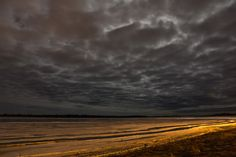 Looking up the Moose River at Moosonee as the breakup approaches. Note vehicle lights aimed at the breakup. 1045 pm