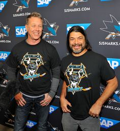 James Hetfield and Robert Trujillo of Metallica receive San Jose Sharks shirts at Metallica Night At The San Jose Sharks Game on January 21, 2015 in San Jose, California.