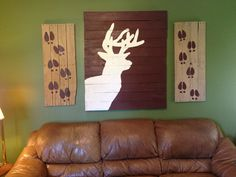 Pallet wall decor.. minus the deer & tracks lol