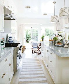 rethinking sparkly counters, and leaning towards white and gray marble for when we have a home again