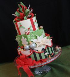 Christmas Cake - A friend asked me to make this for a Christmas Home Tour for her kitchen counter.  Two tiers are red velvet, and one is vanilla, all buttercream with fondant decorations, bows and pointsettias and ornaments.  I did the red roping with a clay extruder.  It was so fun to make.