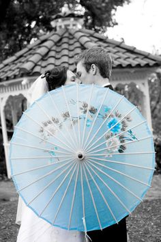 black and white photo with colored umbrella / splash of blue / #photography