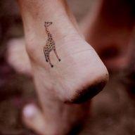 giraffe tattoo <3 dirty ass feet but tats still nice haha