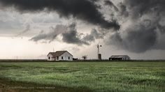 House vs. Supercell II, April 2015 - An old farm house sits tall on the Texas Prairie as a supercell moves in near Hereford, Texas. Photography by Chris Sanner