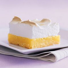 Lemon Meringue Bars: It's as easy as pie to make bars from smooth, tangy lemon filling and fluffy meringue atop a buttery zest-flecked crust.