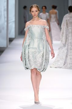 Mint silk zibeline off-the-shoulder dress and puffball cape with silk thread-work and three dimensional crystal hand embroidery. Accompanied with matching belt.