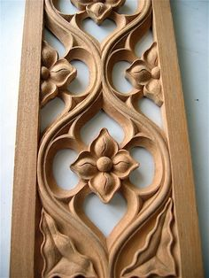 Typical Gothic tracery molding hand carved in wood:
