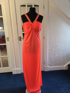 Luminous orange with beade detail straps and low back. Size 16