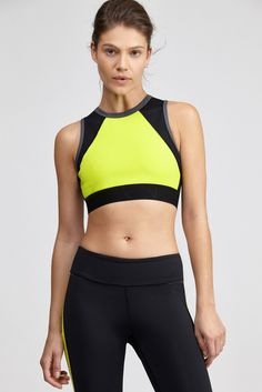 <p>The Swell Crop Top from Alala is a supportive color-blocked bra with a high neckline and perfo...