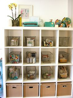 vintage locker baskets to store craft supplies // kraft boxes from IKEA for Expedit  {craft room tour with Lexi Bridges}