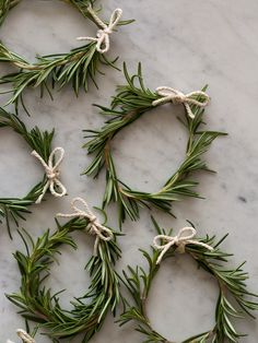 Rosemary napkin rings or place-card holders by spoon, fork, bacon. Rosemary, floral wire and twine. Perfect!