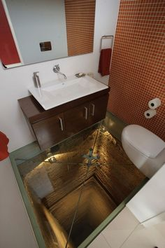 Bathroom over an abandoned 15-story elevator shaft by Hernandez Silva Arquitectos. Convenient for those who may wet themselves when faced with heights.