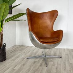 Luxury Leather and Steel Egg Chair. Brown leather armchair is a swivel chair and comes with free UK delivery! Brown Leather Armchair, Leather Club Chairs, Desk Chair, Swivel Chair, Aluminum Uses, Large Desk, Wing Chair, Free Uk, Office Furniture