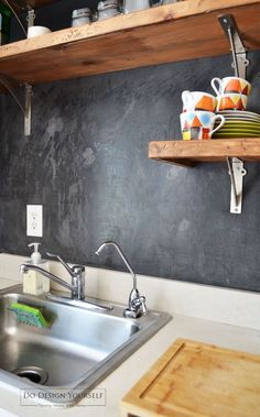 How I painted my travertine backsplash in three easy steps.How I painted my travertine backsplash in three easy steps.How to paint a tile backsplash: kitchen renovationHow to paint a tile backsplash. This simple tutorial will Cheap Kitchen Backsplash, Stove Backsplash, Paint Backsplash, Cheap Kitchen Remodel, Black Backsplash, Kitchen Paint, Ikea Kitchen, Kitchen Furniture, Kitchen Design