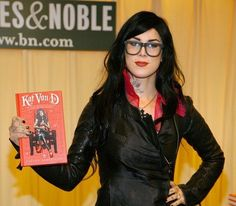 Kat von D, very stylish wearing glasses and red lipstick