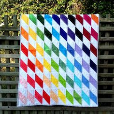 Looking for your next project? You're going to love Rainbow Diamonds Baby Quilt by designer Linda Robertus.