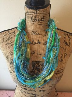 blue green fiber necklace/yarn scarf with adjustable bead