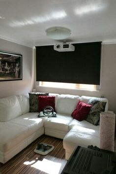Home cinema with white leather corner sofa, blackout blind, walnut flooring. Patio Blinds, Diy Blinds, Outdoor Blinds, Bamboo Blinds, Fabric Blinds, Curtains With Blinds, Sheer Blinds, Blinds Ideas, Privacy Blinds