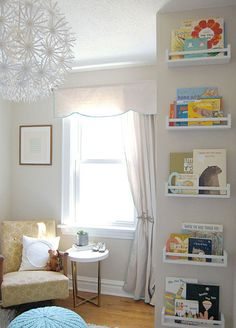 Spacesaving IKEA hack -- use spice racks for low profile book shelves! Also, I love the window treatments!