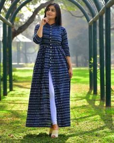 Shop online Sunset ikat tunic This tunic in navy blue with ivory ikat will give you the perfect global Indian look. It is gathered at the waist and has a long slit in the front to add to the glam. Dress Indian Style, Indian Dresses, Indian Outfits, Indian Designer Outfits, Designer Dresses, Designer Clothing, African Fashion Dresses, Indian Fashion, Frock Fashion