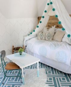 Girl's room with DIY canopy bed featuring pendant light.