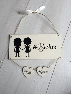 Our #bestie plaque makes a fab friendship gift for your best friend or sister! Personalised with yours and your besties  name. The picture shows two friends holding hands. Super cute gift to keep forever.  Plaque measures approx. 20cm by 10cm, handpainted in linen cream with black calligraphy style