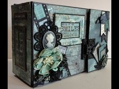 Have made a 9 x 6 mini album with the beautiful blue/ green Blue Bay papers from Kaisercraft.This album have only 4 pages but there are a lot of pockets, fli...