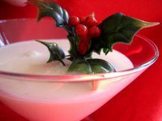 COCONUT SNOWBALL MARTINI:  3/4 cup half-and-half,  1/2 cup coconut-flavored rum,  1/4 cup vanilla vodka,  1/4 cup cream of coconut