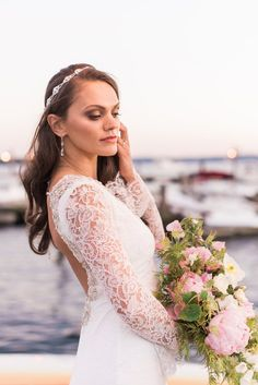 Nautical Styled Shoot... Photo By B. Jones Photography.. Hair / Make-up by Kathy Evans Beauty Studio.. Hair accessories / veil from Belaire Bridal.. Jewelry from Heidi Hull.. Models, Katya, Taylour, and Nick.. Floral by Bellafiori..  Tux by the Form House.. dresses from MeaMarie Bridal Ateleir. 1st is Kenneth Winston Style 1573 and next 3 are Atelier Pronovias .. Coordinating and decor by Snohomish Rental Co
