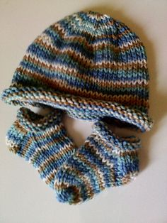 This is a very simple and easy sock pattern. This goes great with a simple rolled brim hat. It makes a nice charity set. You can use the same double pointed needles for the hat and for the socks. It goes very quick.