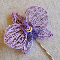 Quilled Orchid Pin by all things paper, via Flickr