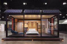 Shipping container house with glass walls