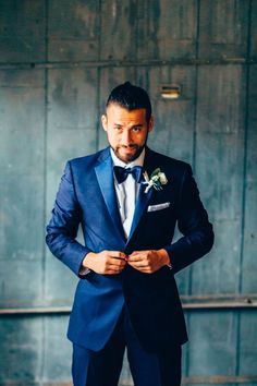 Groom navy blue tuxedo - Derek Halkett Photography