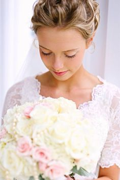 Copyright Photos by Courtney Sharlenae Collingsworth  Gorgeous dress, hair, and bouquet