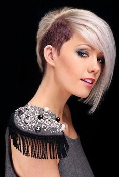 Half shaved hairstyle with long fringe