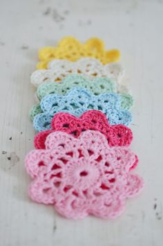 Flower coasters , found on  : http://www.molliemakes.com/projects/how-to-make-crochet-flower-coasters/