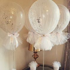 Tulle balloons with silver confetti for a Holy Communion, or Baby Shower. So pretty!