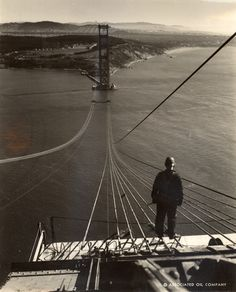 Charles M. Hiller - Footbridge ropes stretch across the Golden Gate Bridge under construction. San Francisco, California, September 1935.