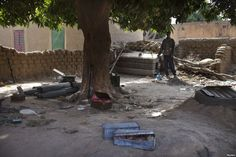 Local resident Issa Dembele stands next to munitions, believed to belong to Islamist rebels, stockpiled in the courtyard of his house in Diabaly, Mali, Jan. 23, 2013.  Children Are Main Victims of Leftover Munitions in Mali