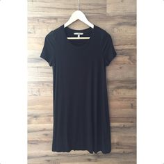 """Basic Black Swing Dress Basic casual fit jersey Swing dress.Perfect for everyday!  92% Rayon 8% Spandex  S-33"""" M-34"""" L-35""""  Runs true to Size  Dry Clean  MADE IN THE USA Dresses Mini"""